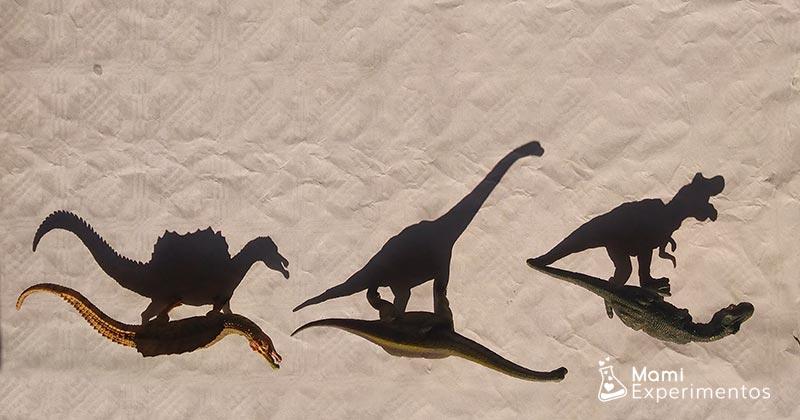 Arte con sombras tres dinosaurios