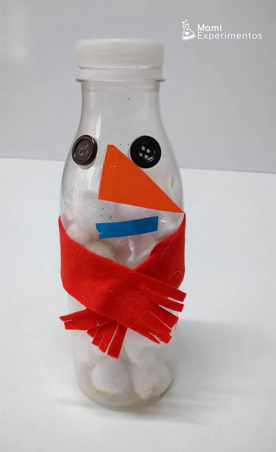Botella sensorial muñeco de nieve con pompones blancos