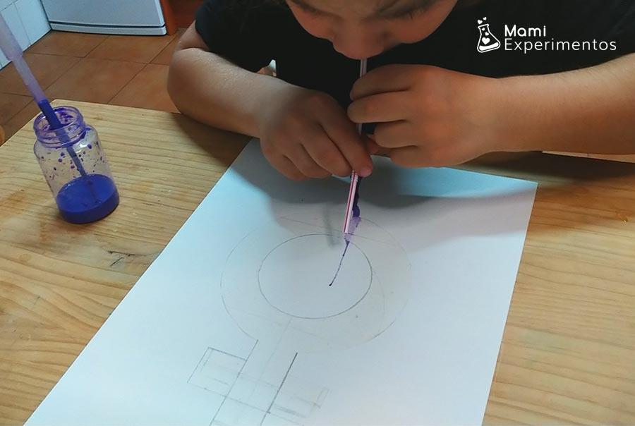 comenzando a dibujar soplando para actividad día de la mujer