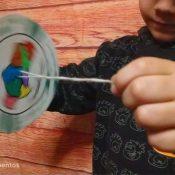 Experimento científico crear spiners del día de Andalucía