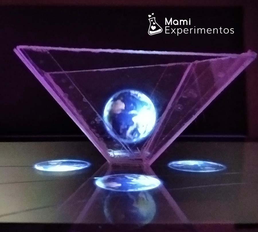 Observar planeta tierra en holograma casero taller sobre el universo