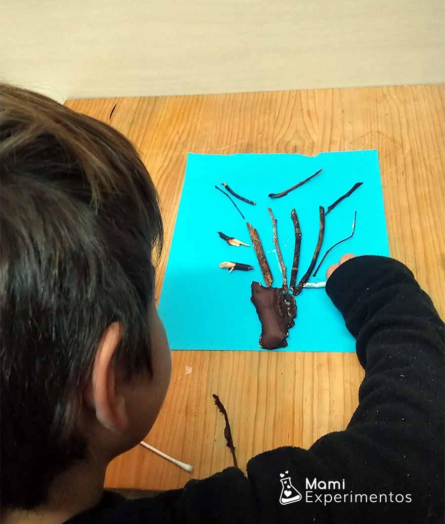 Pegando ramas y palos árbol de invierno artístico