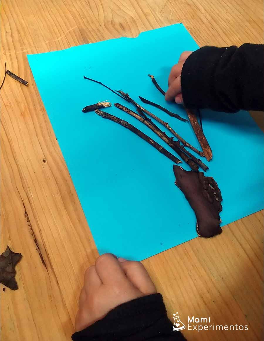 Colocando ramas y palos para árbol de invierno artístico